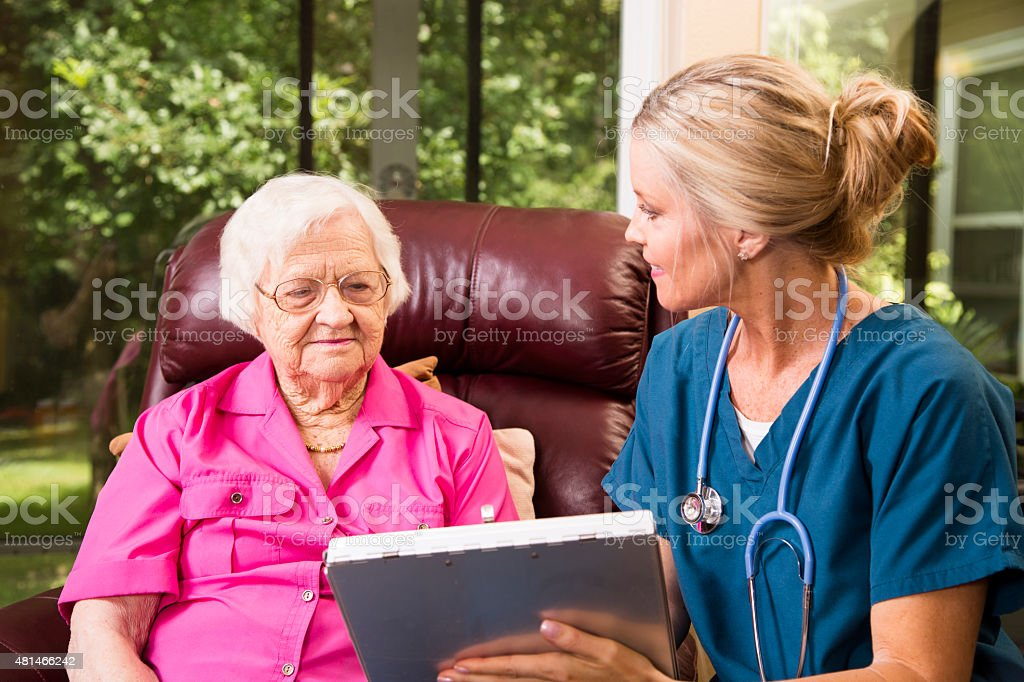 Home healthcare nurse with senior adult patient. stock photo