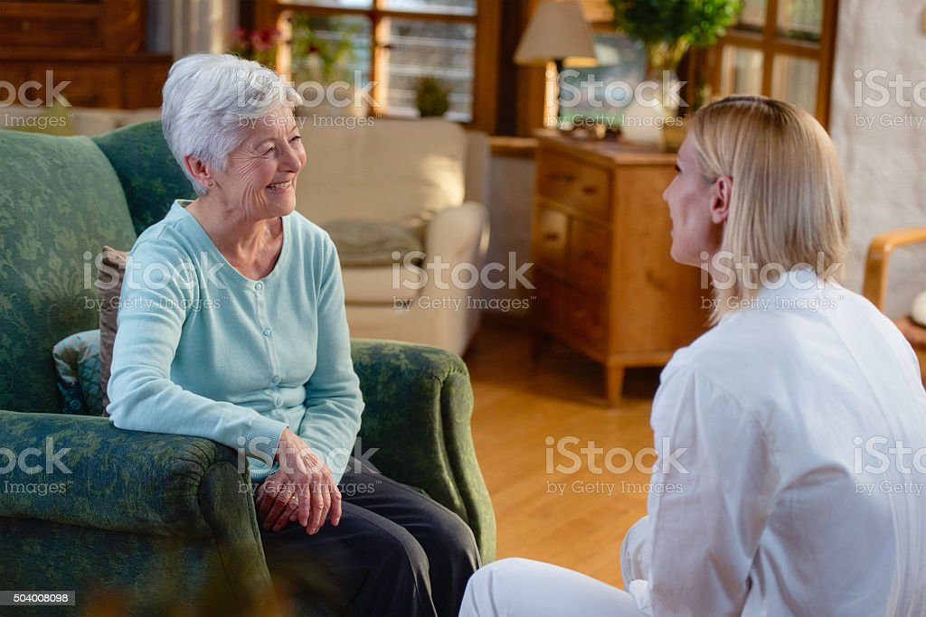 Home healthcare nurse with senior adult patient stock photo