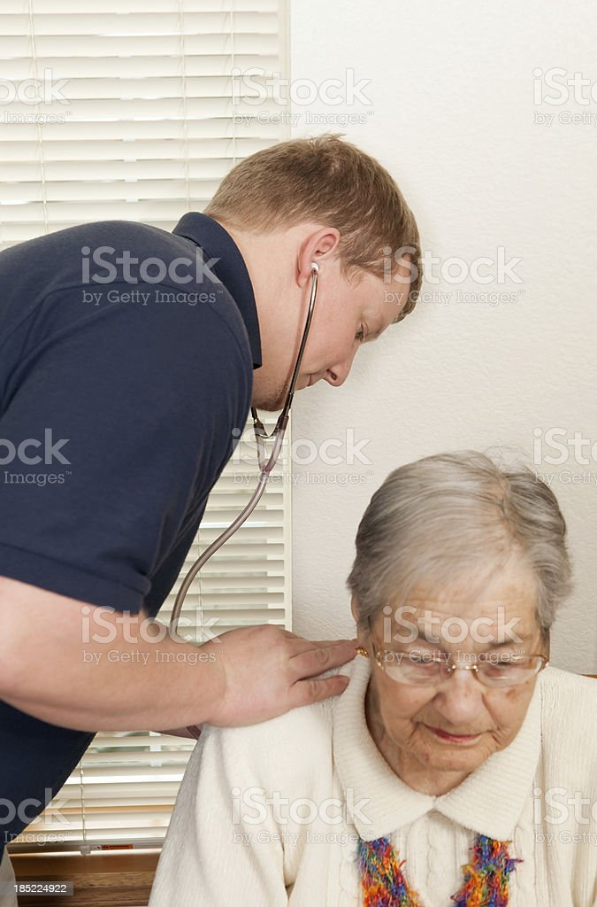 Home Healthcare Worker Checking Heart of Senior Patient royalty-free stock photo