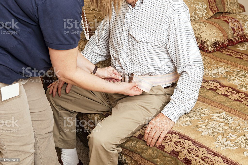 Home Healthcare Worker Fastening Gait Belt royalty-free stock photo