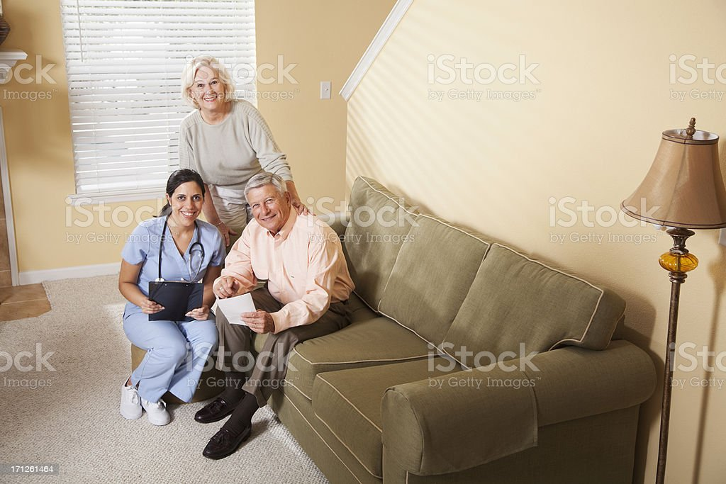 Home healthcare worker helping patient stock photo