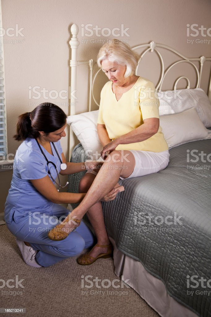 Home healthcare worker with senior patient stock photo