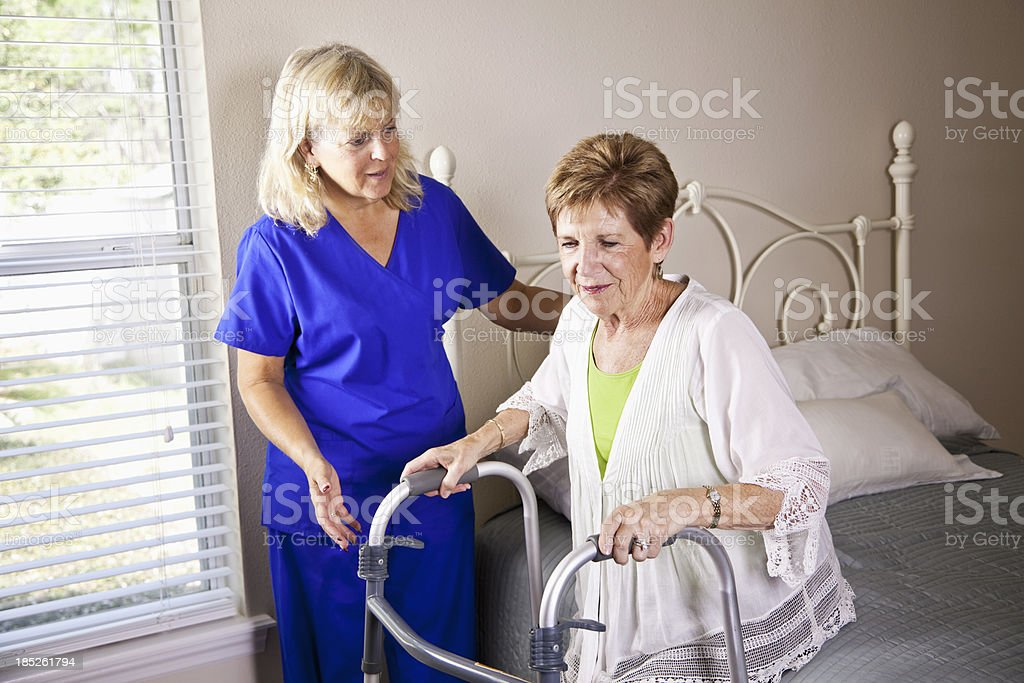 Home healthcare worker with senior woman stock photo