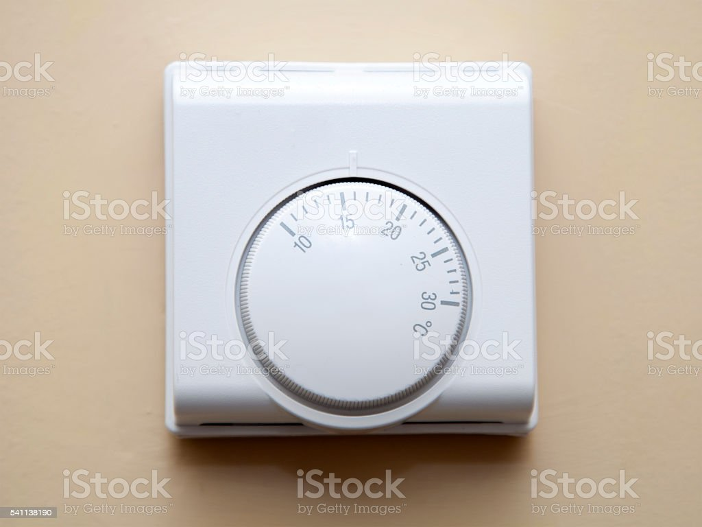 Home Heating Thermostat on a Wall stock photo