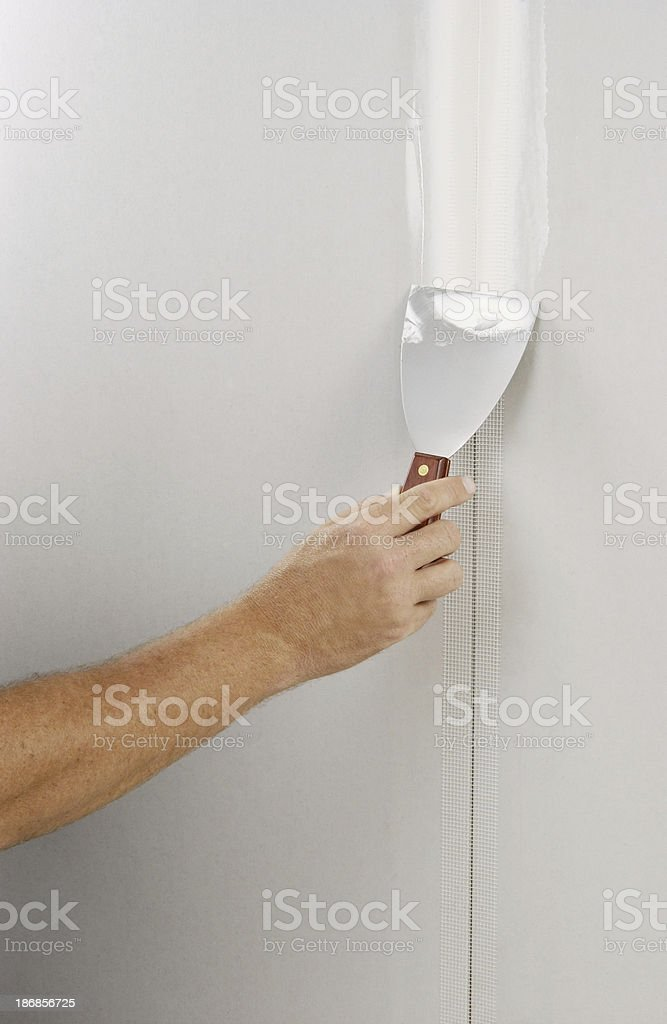 Home improvement and fixing walls stock photo