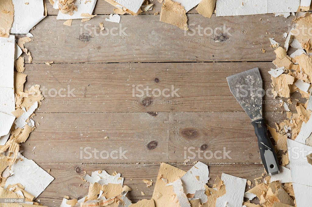 DIY Home Improvement background with wallpaper and scraper stock photo