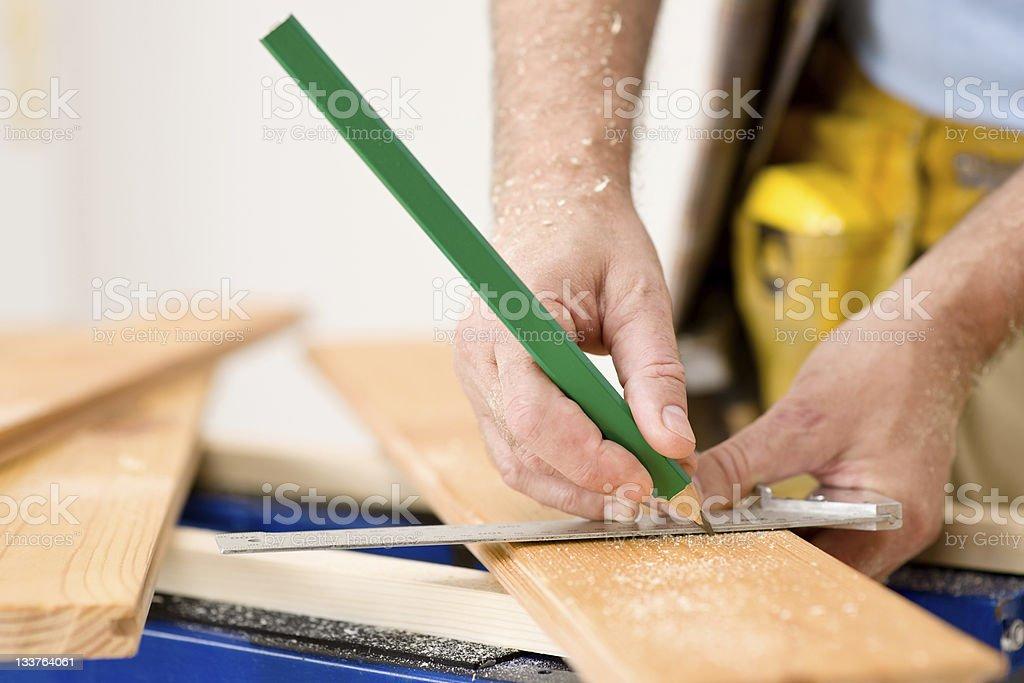 Home improvement - close-up of handyman measure wood stock photo