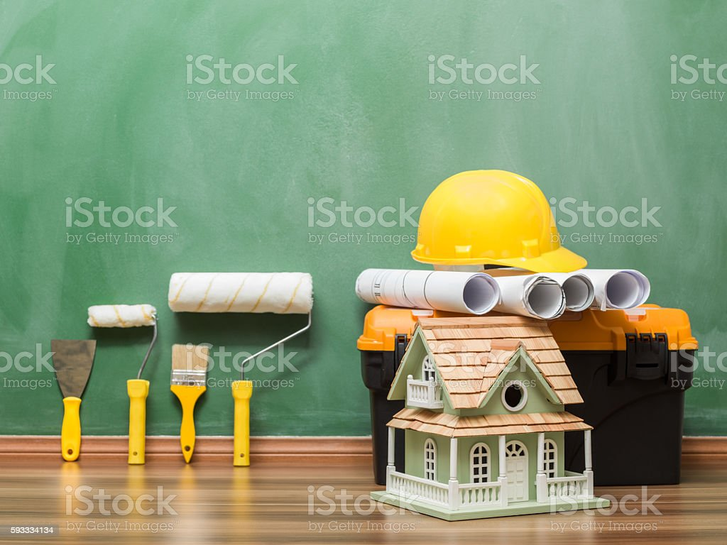 Home improvement equipments and blueprints on blackboard stock photo