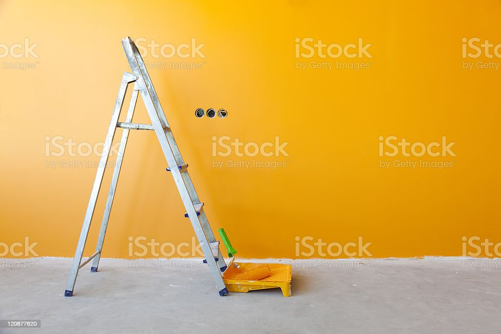 Home Improvement /  ladder, paint can and  roller stock photo