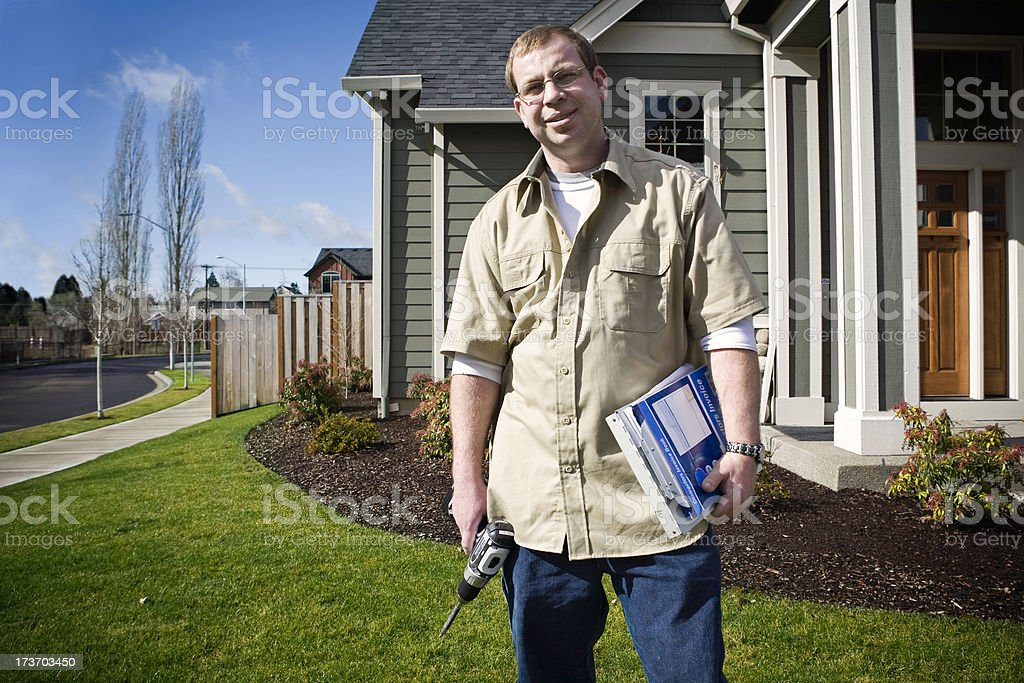 Home Improvement Man Outside of House royalty-free stock photo