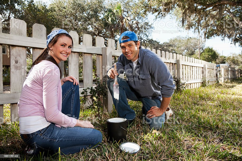 Home improvement - painting fence stock photo