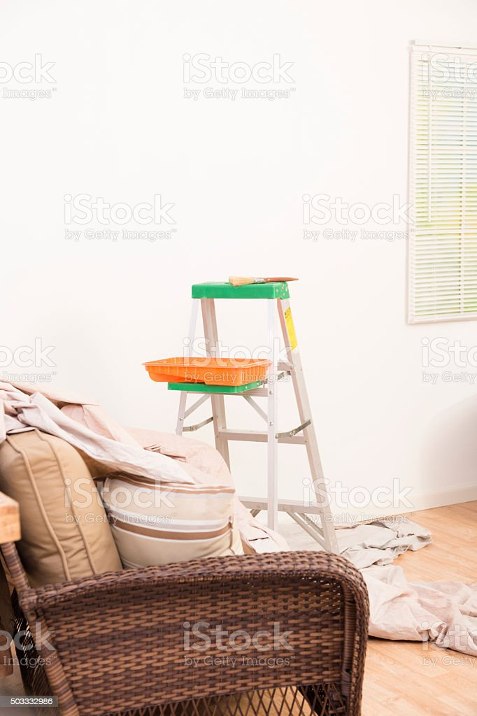 Home improvement. Painting supplies, ladder, drop cloth. Furniture. stock photo