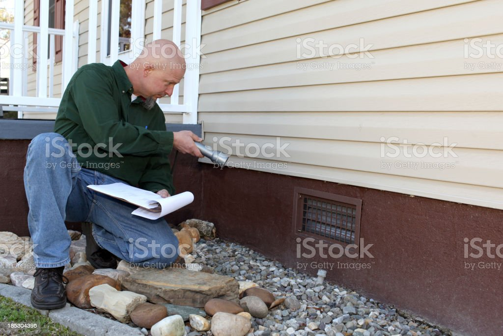 Home inspector checking the foundation. stock photo