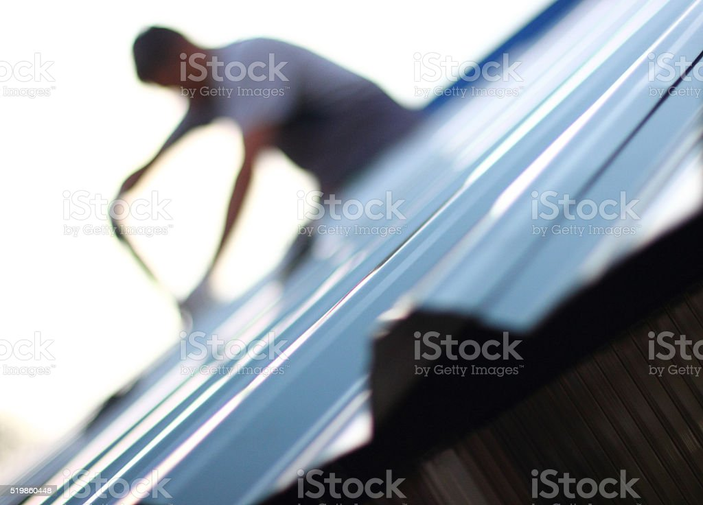 Home Inspector, on the roof stock photo