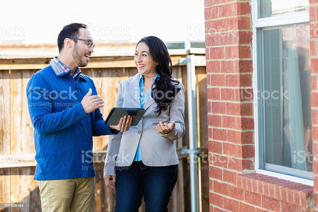 Home inspector talks with homeowner stock photo