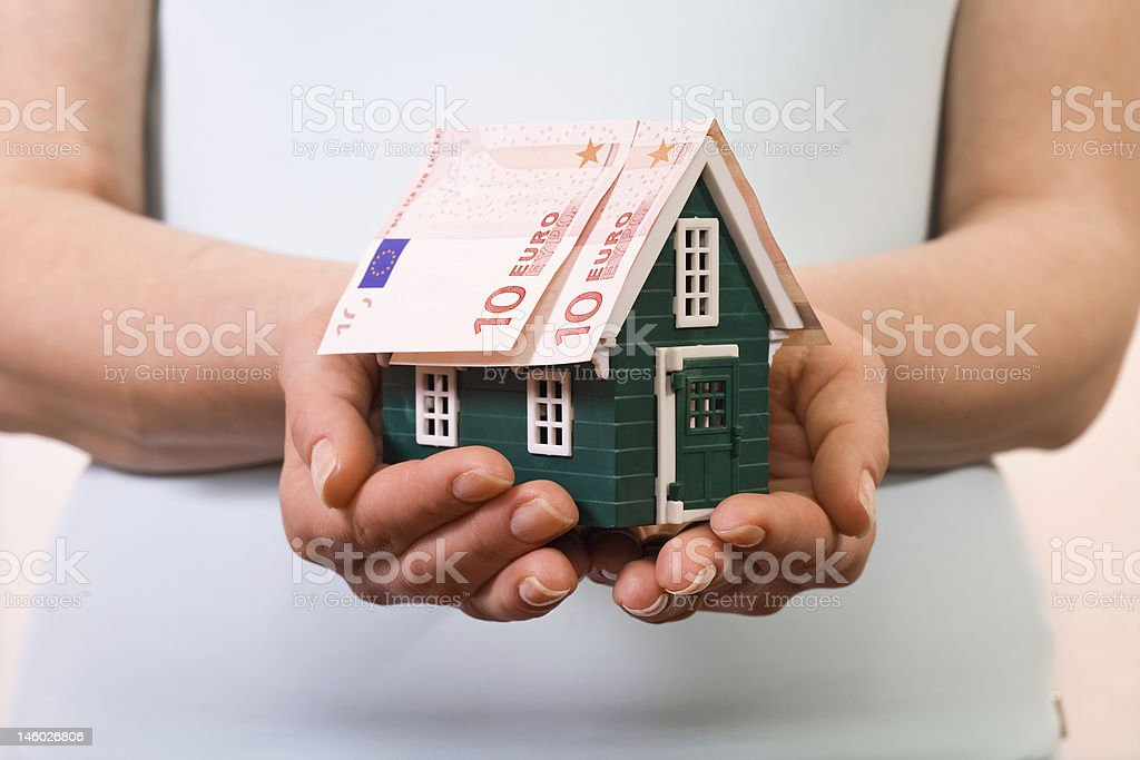 Home insurance concept with euro banknotes royalty-free stock photo