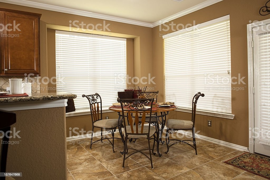 Home interior showing breakfast table, back door and kitchen bar royalty-free stock photo
