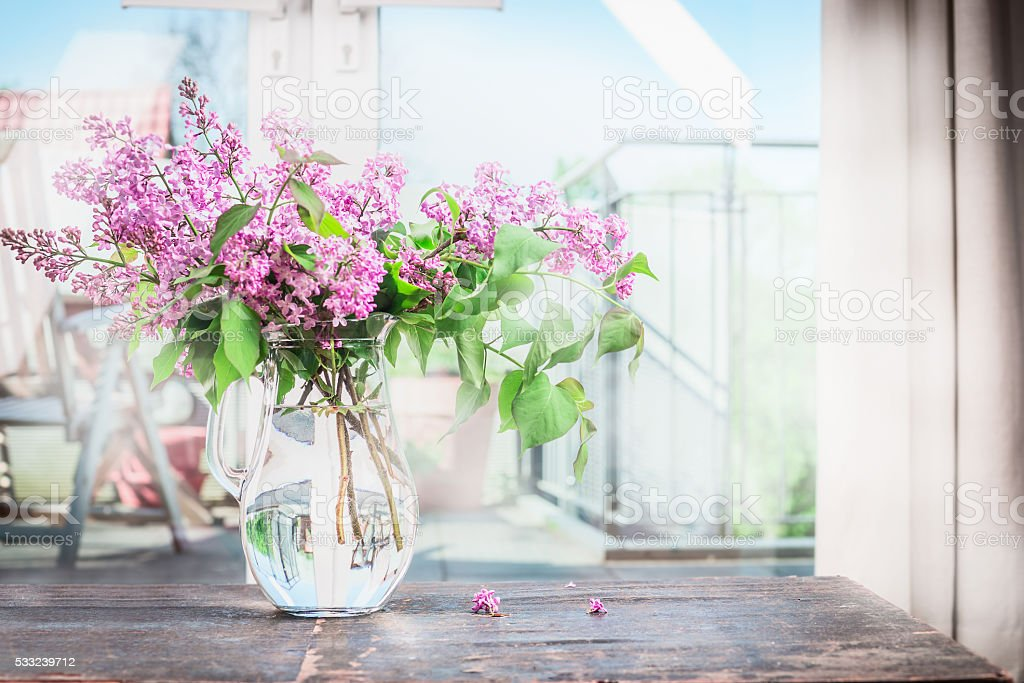Home interior with Bouquet  of blooming lilac flowers stock photo