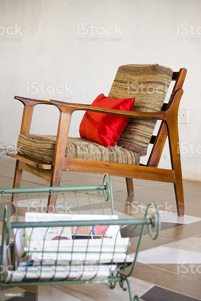 home interior with chair cushion and magazine rack stock photo