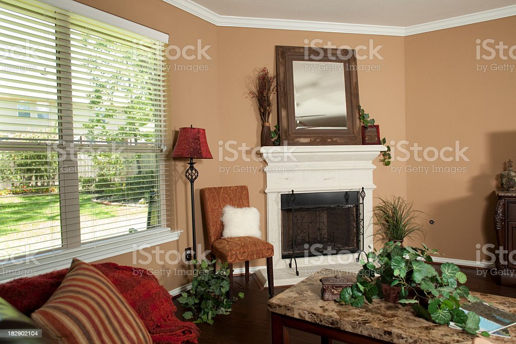 Home interior with fireplace and windows royalty-free stock photo