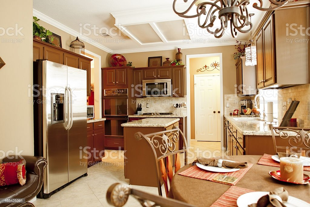 Home Interiors: Kitchen with new granite, stainless appliances. Breakfast table. stock photo