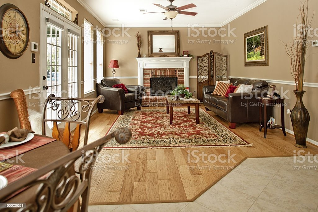 Home Interiors: Living room with decor, sofa, chair, fireplace. stock photo