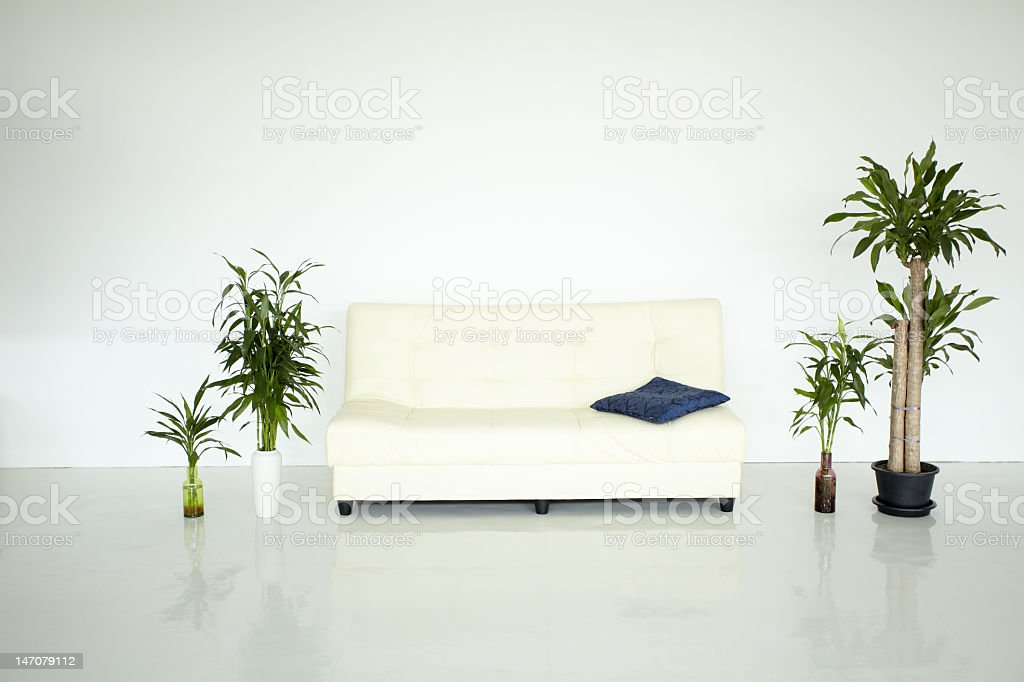 home interrior. simple living room. bed with few plants stock photo