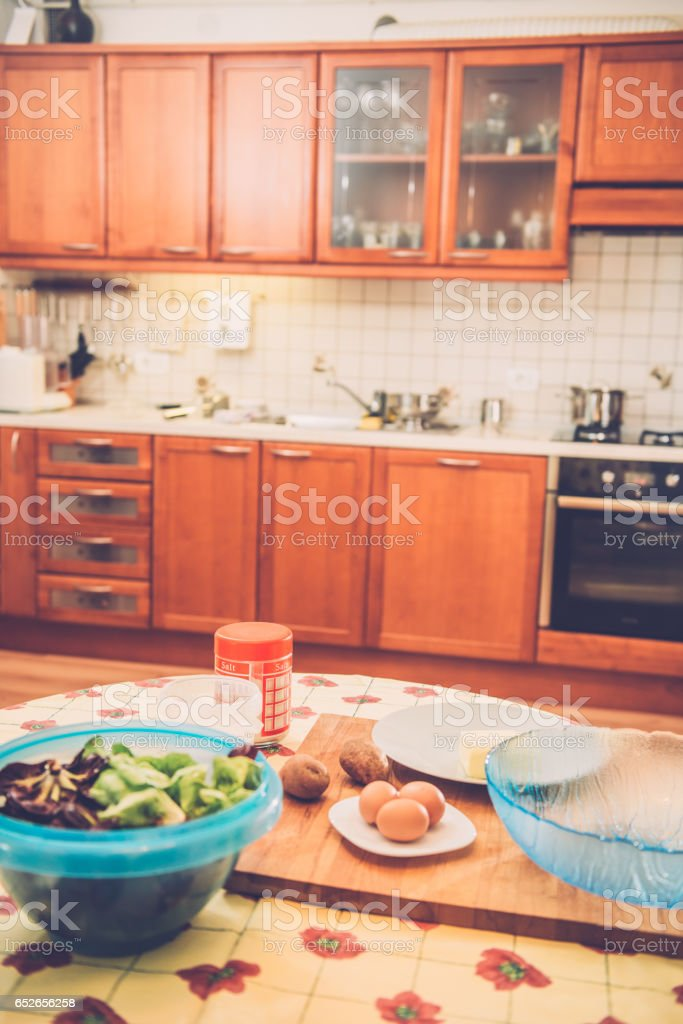 Home Kitchen with Some Gnocchi Ingredients and Salat stock photo