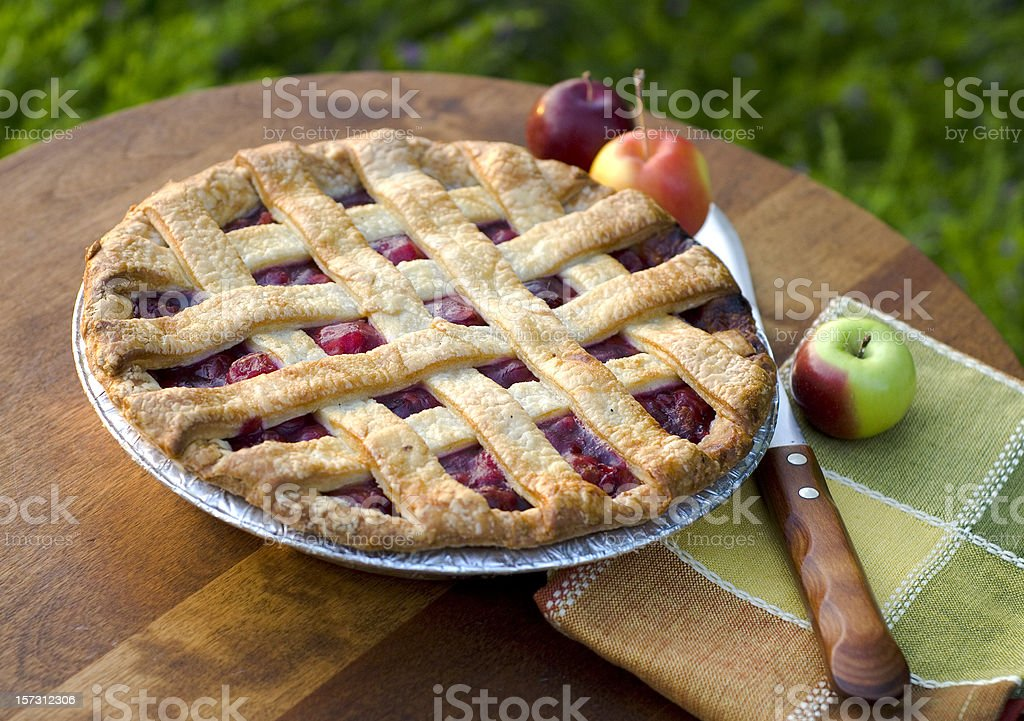 A home made cherry pie on a wooden table stock photo