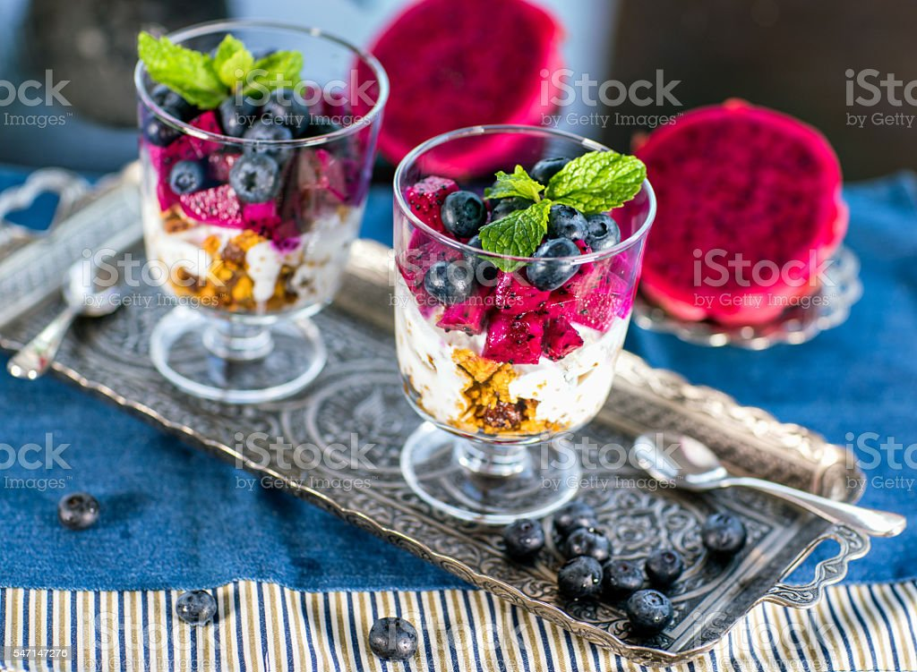 Home made granola with  yogurt and fruits stock photo