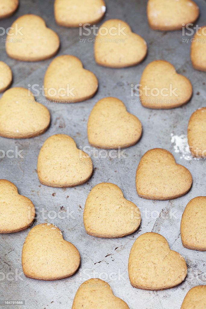 Home made heart shaped cookies on baking tray royalty-free stock photo