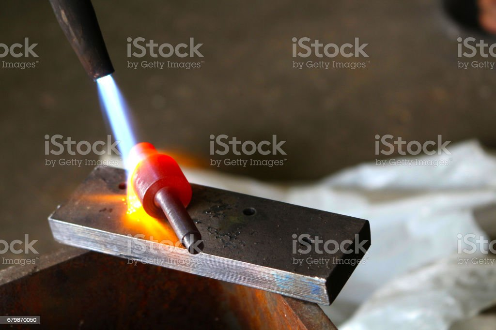 DIY home made metal hardening with gas cutting torch stock photo