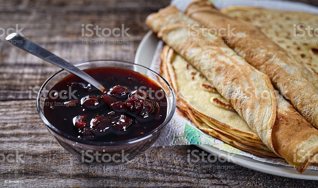 Home made pancakes with cherry jam stock photo