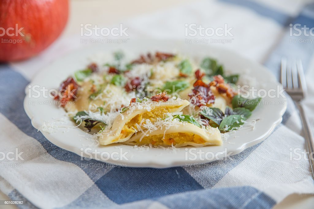 home made pasta stuffed with pumpkin on a plate stock photo