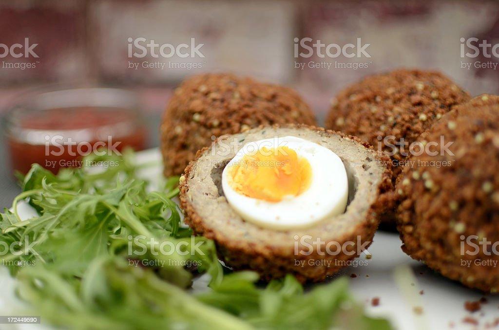 Home made scotch eggs stock photo
