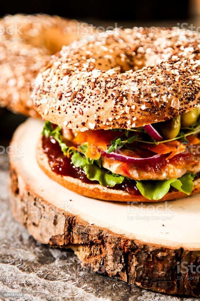 Home made tuna sandwich bagel with lettuce and sauce stock photo