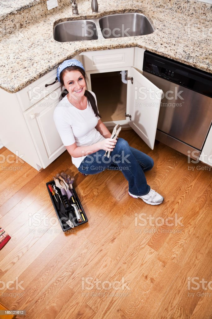 Home maintenance, fixing kitchen sink stock photo