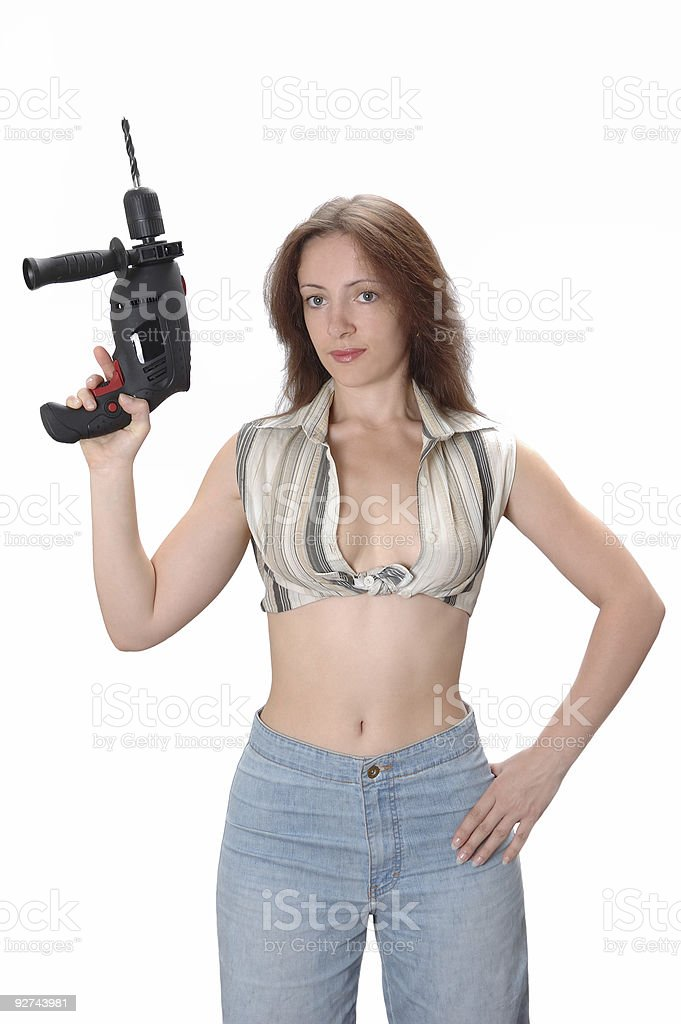 Home Maintenance. The girl with a drill. stock photo