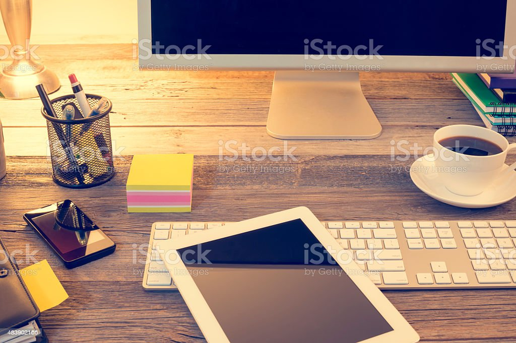 Home office desk with computer monitor. stock photo