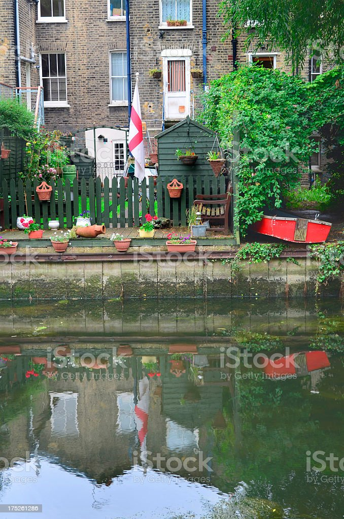 home on canal bank stock photo