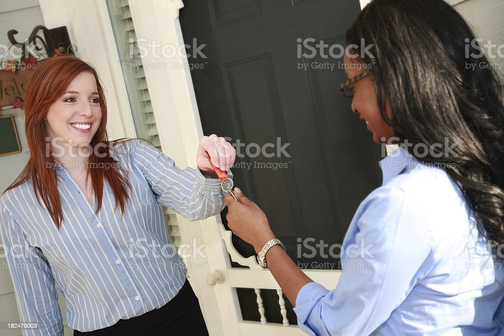 Home Owner Receiving Keys to New House from Realtor royalty-free stock photo
