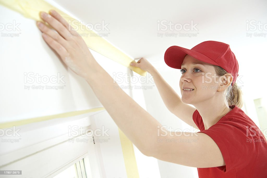 Home Painter with masking tape stock photo