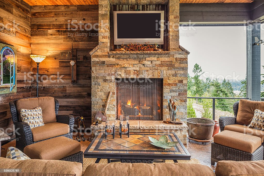 Home Patio: Outdoor Patio with Couch, TV, Fireplace stock photo