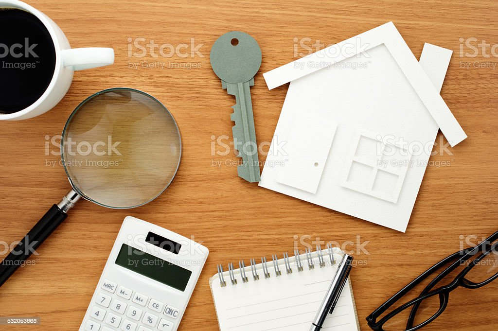 Home planning. Calculating and checking. stock photo