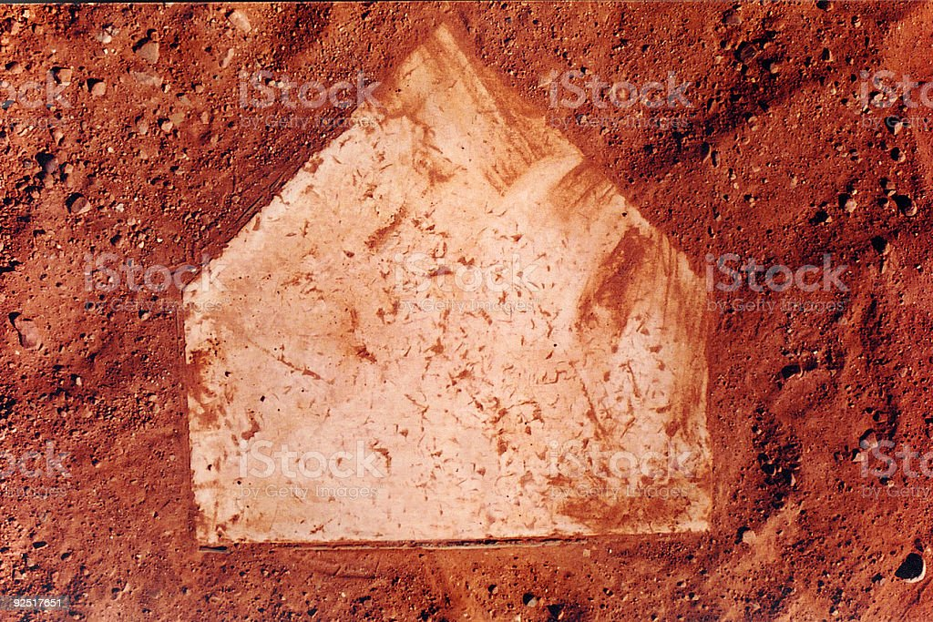 Home Plate on a Baseball field with red dirt stock photo