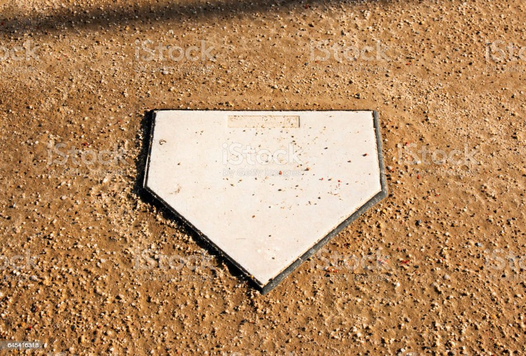 Home plate on a dirt field stock photo