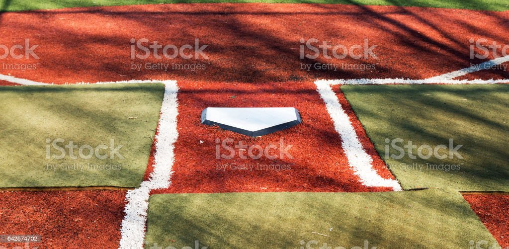 Home plate on a turf field stock photo