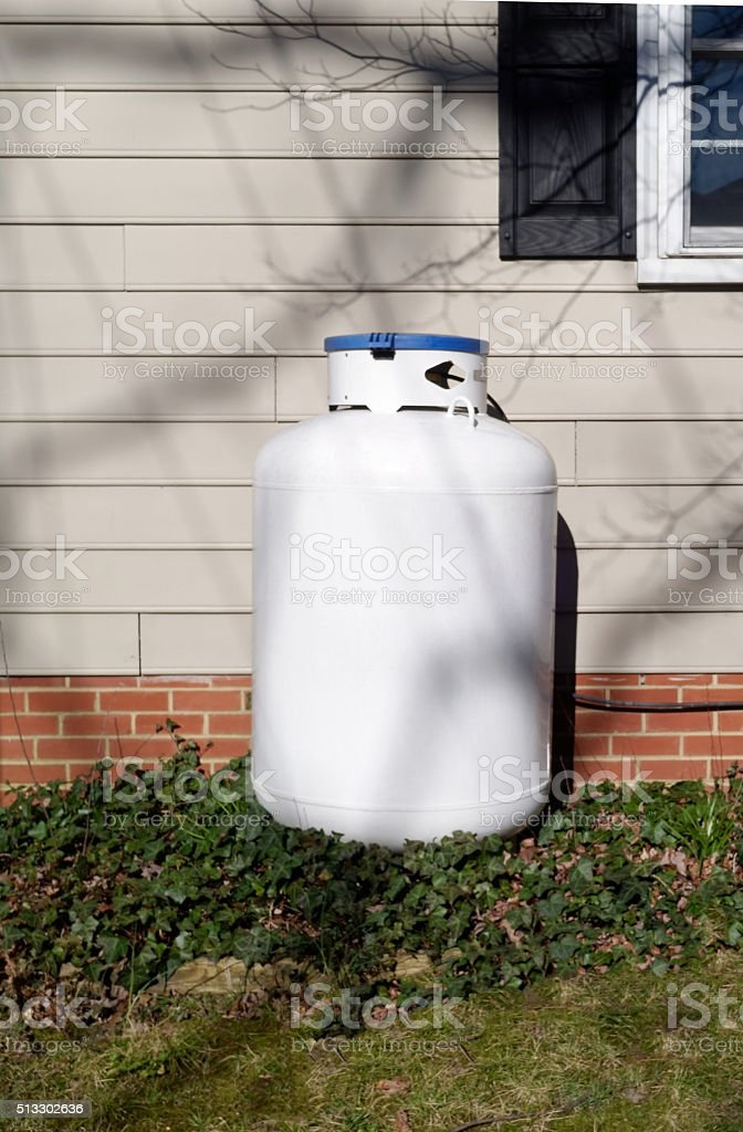 Home Propane Tank Against Side of House stock photo