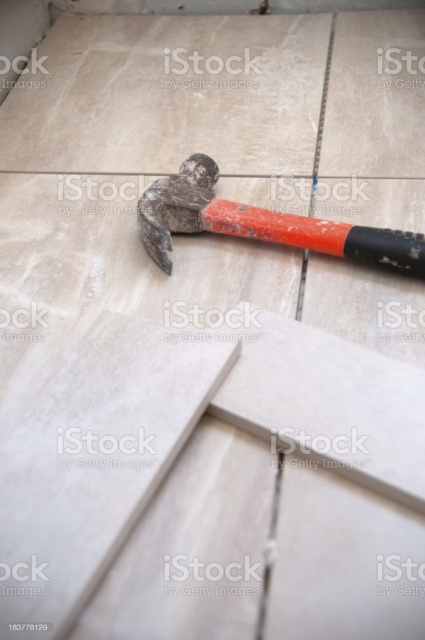 Home Renovation, Tiling Process: Tile pieces and Hammer royalty-free stock photo