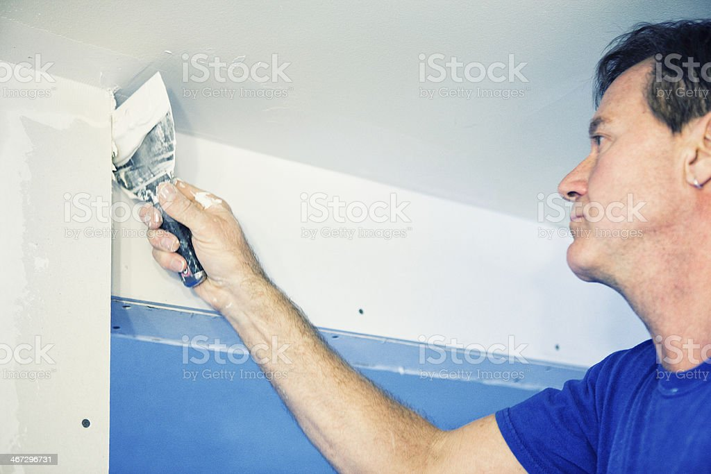 Home Renovations - Drywall Mudding stock photo